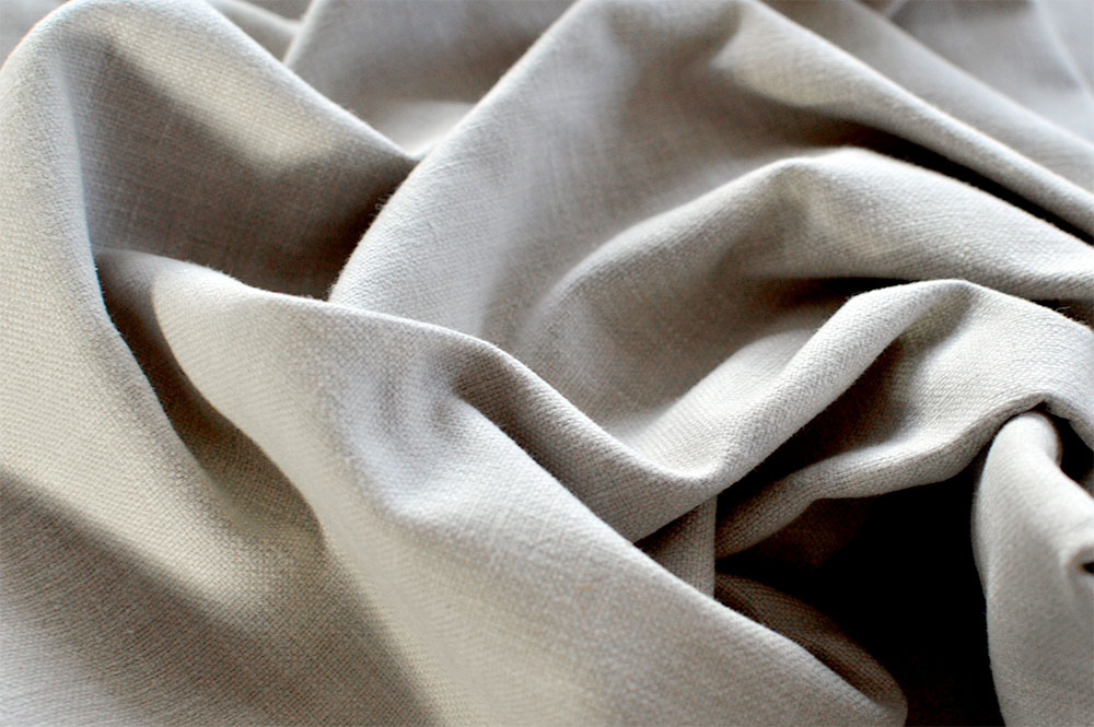 Prestigious faux linen brown curtain fabric
